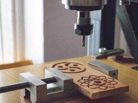 wood cutting machine 3D wood cnc router. CNC milling machine carving a wooden part blank. Cutter